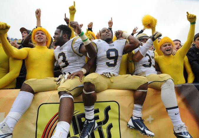Georgia Tech football players celebrating with the student body